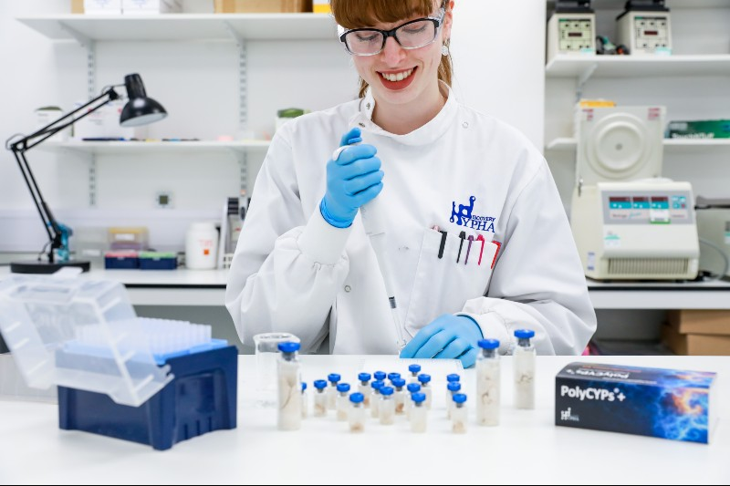 scientist smiling while using polycyps kit