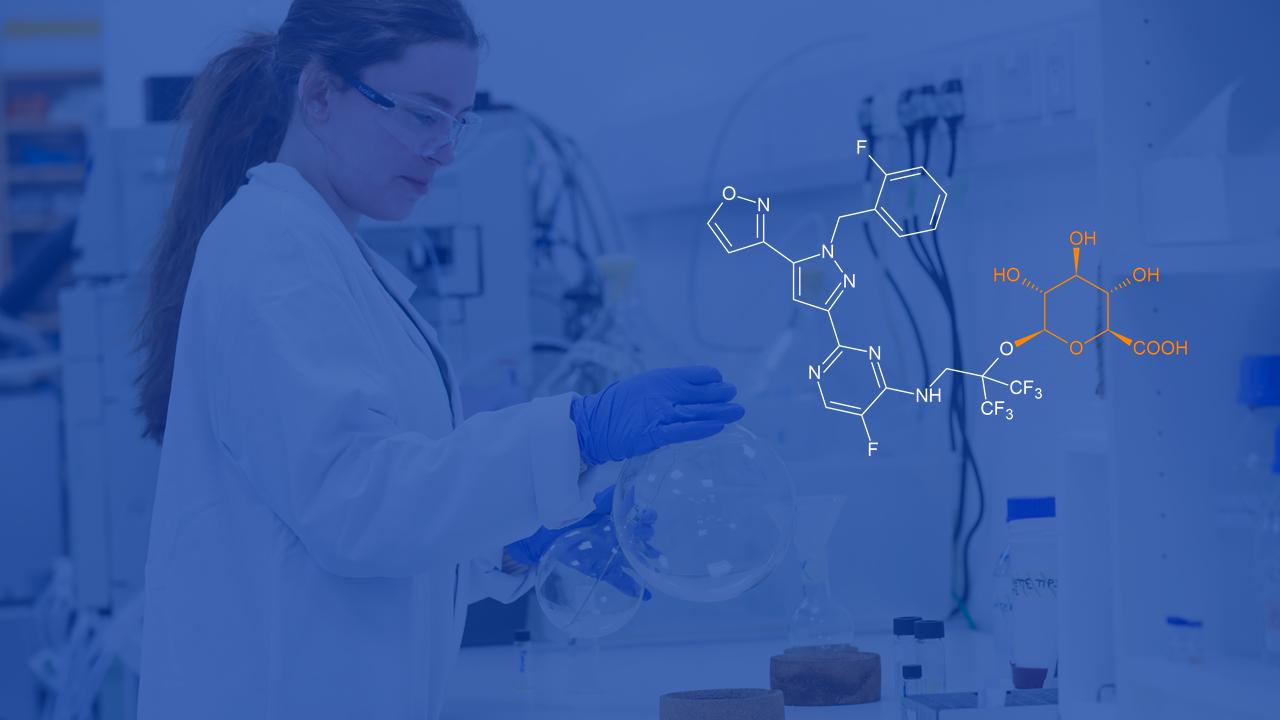 Poster image of Scientist holding beaker
