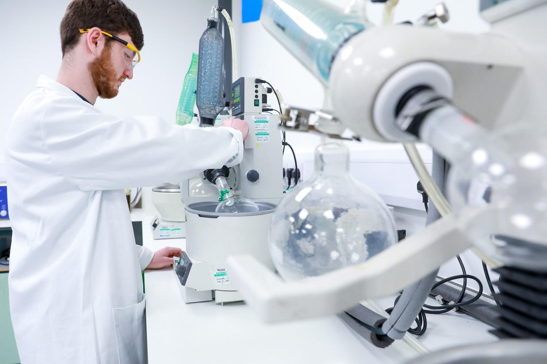 Scientist using machine