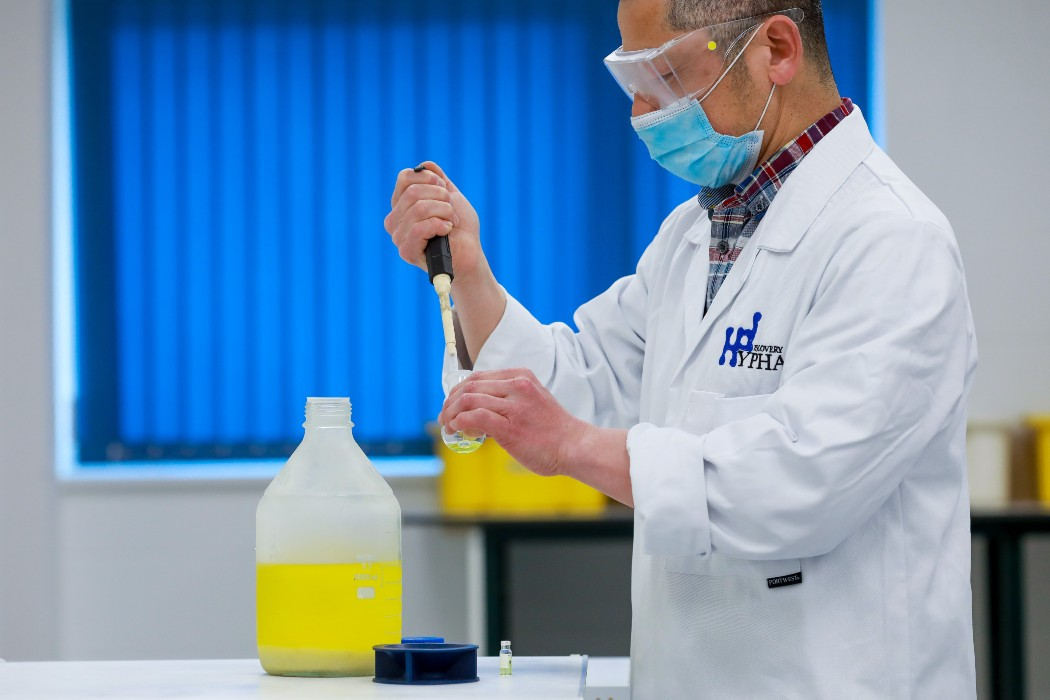 scientist standing whilst doing an expriment